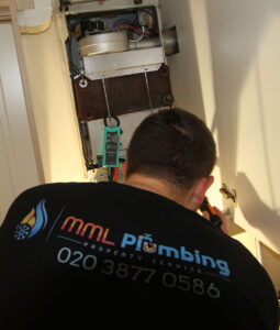 our plumber checking out the boiler function