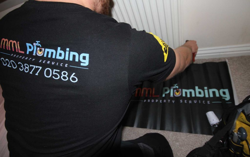Our plumber fixing a radiator