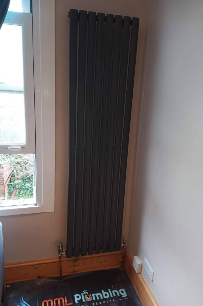 plumber installing a column radiator