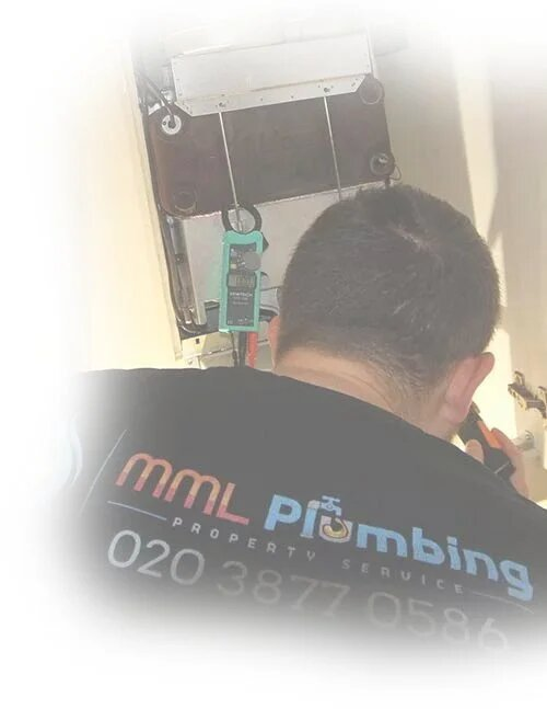qualified plumber working on a boiler